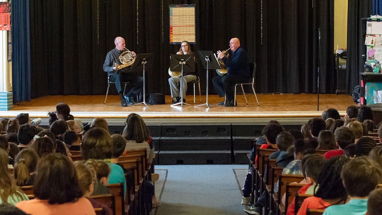 A French Horn Trio from the BPO performs for students