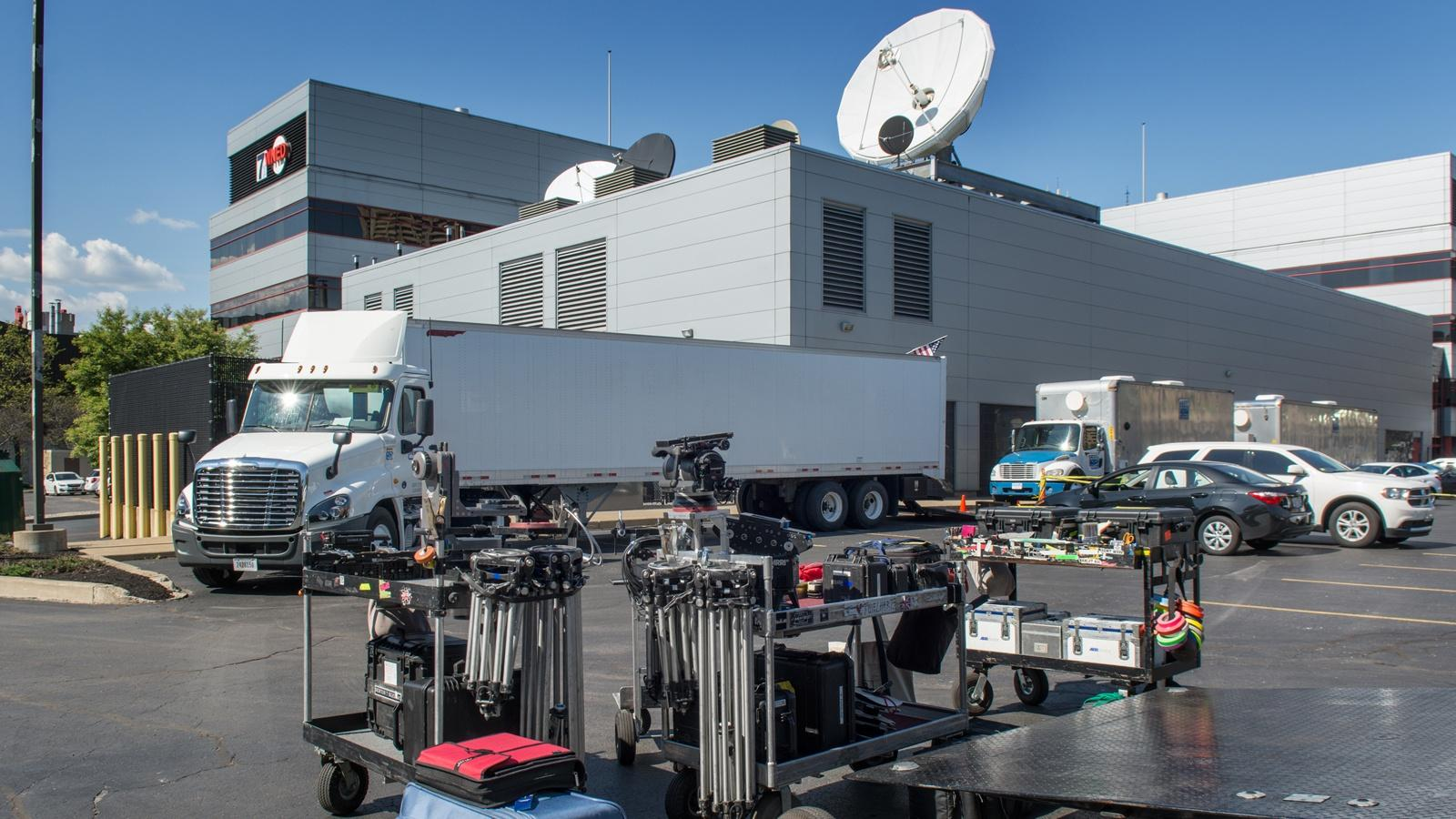 Film trucks in teh WNED | WBFO parking lot during the filming of Marshall