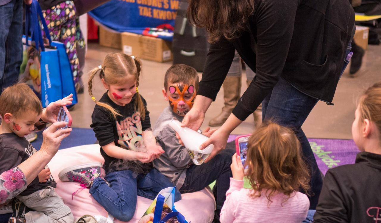 Kids learning about science with the help of the Buffalo Museum of Science