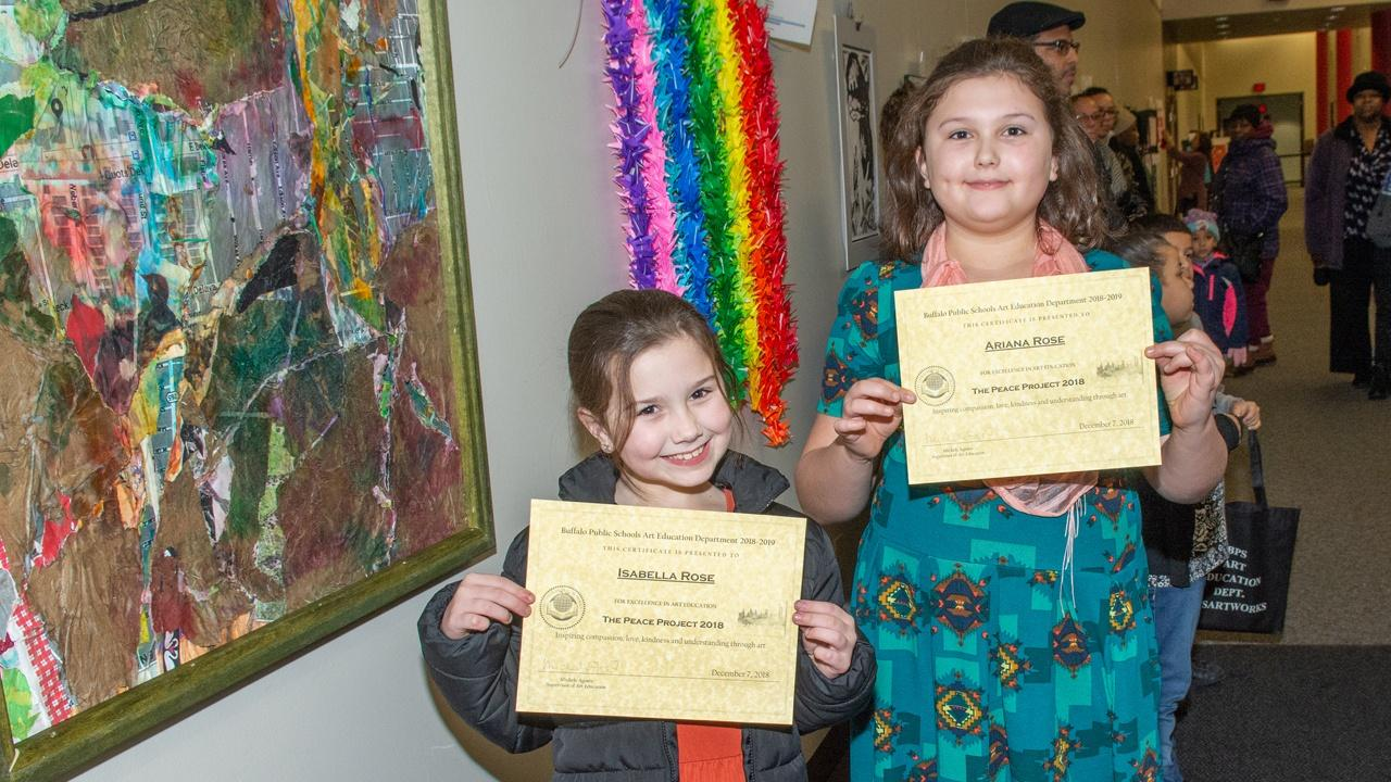 Isabella Rose and Ariana Rose pose with certificates