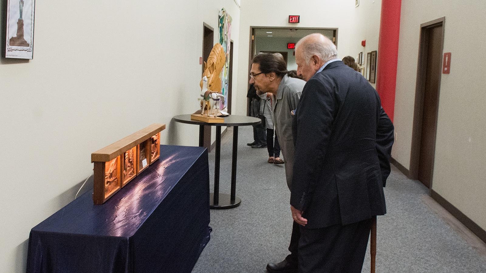 Visitors viewing artwork on display at Horizons Gallery