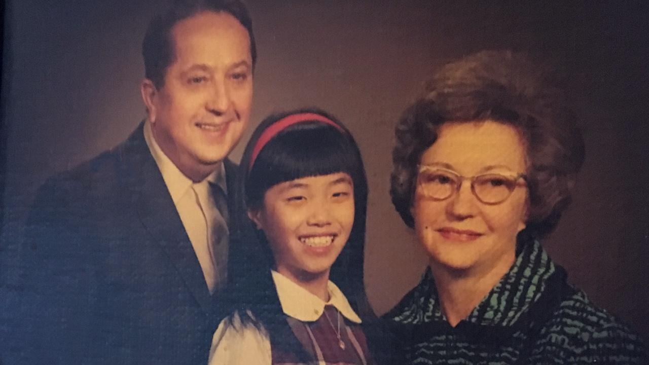 phot of young Judi with adopted parents