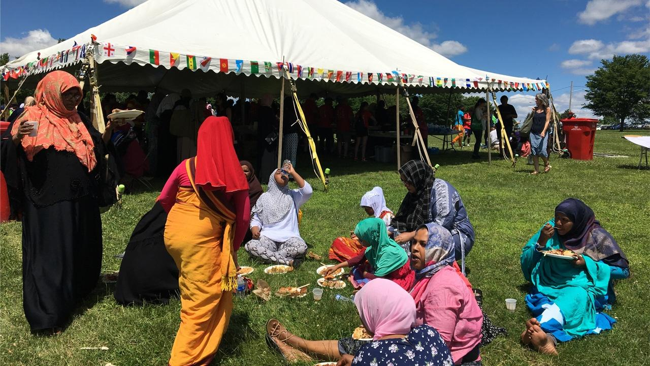 crowd enjoying some food at Buffalo's World Refugee celebrations