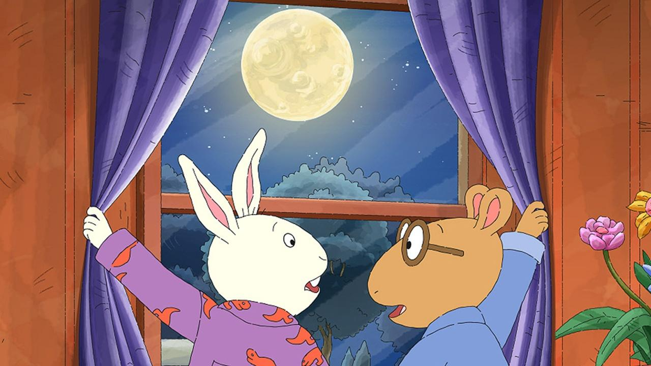 Arthur looking out window to full moon