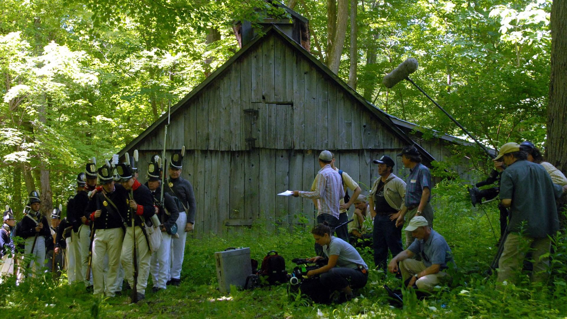 The crew films a re-enactment scene for the War of 1812.