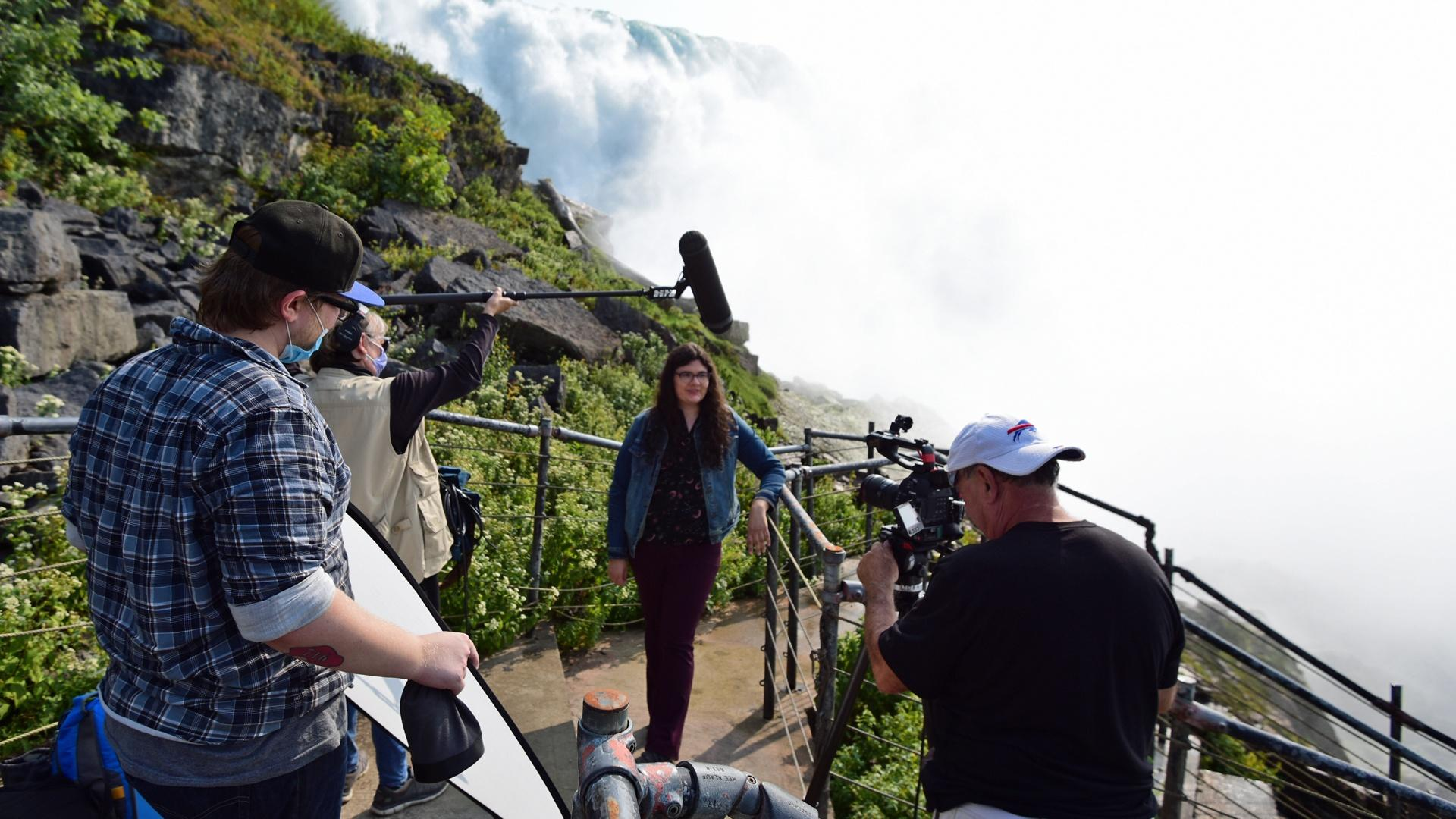 Bailey Critopn, Tami Coleman and Jim Zinkowski record an epsiode of Compact Science with host Sarajane Gomlak-Green at the base of Niagara Falls