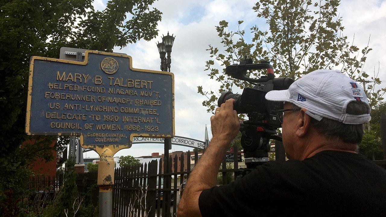cinematographer Jim Zinkowski shooting a historic marker