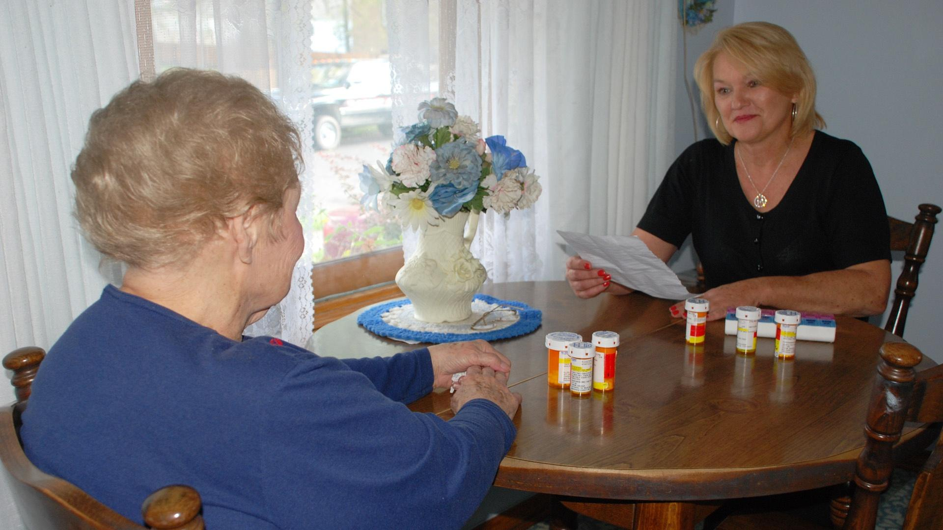 DAughter helping to organize her mother's medication