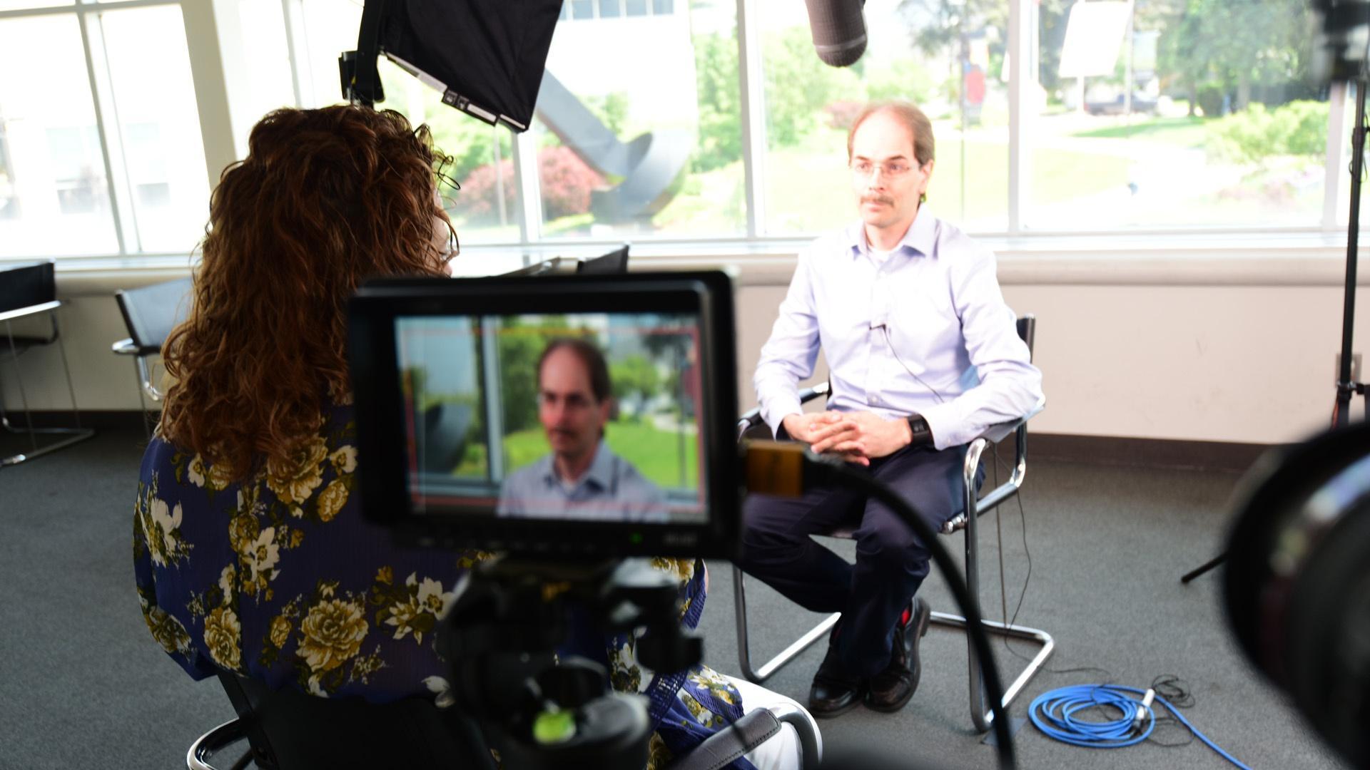 Community filmmaker Paul Dobbs being interviewed by WNED-TV