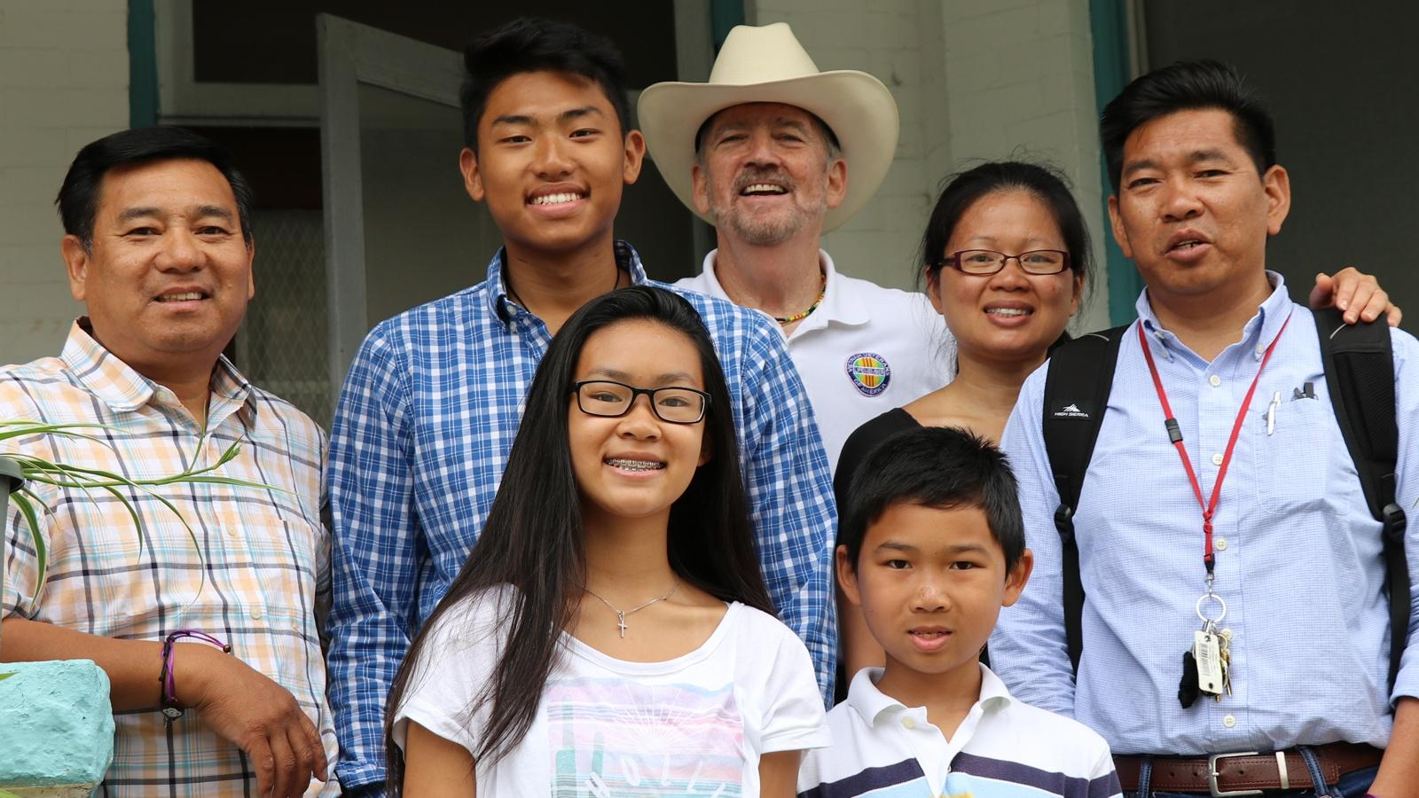 Brothers Minh and Tom Trân, their family, and Vietnam veteran Norm Murray.