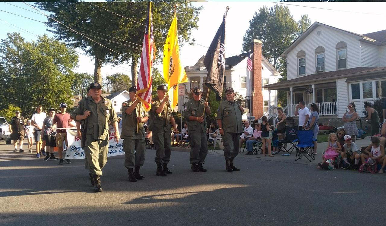 Chapter 77 marches in color guard formation throughout the entire parade route at the Canalfest parade in Tonawanda, NY.