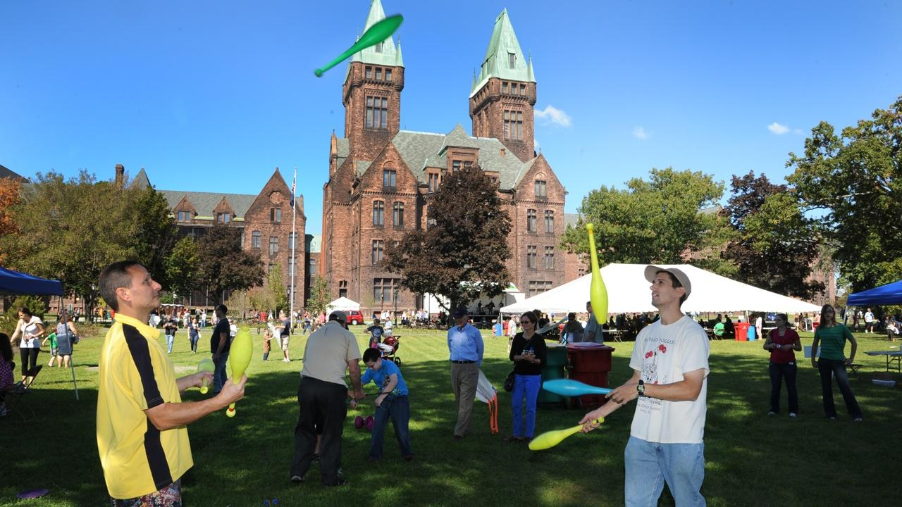 Jugglers and other activities as the public gathers on the South Lawn