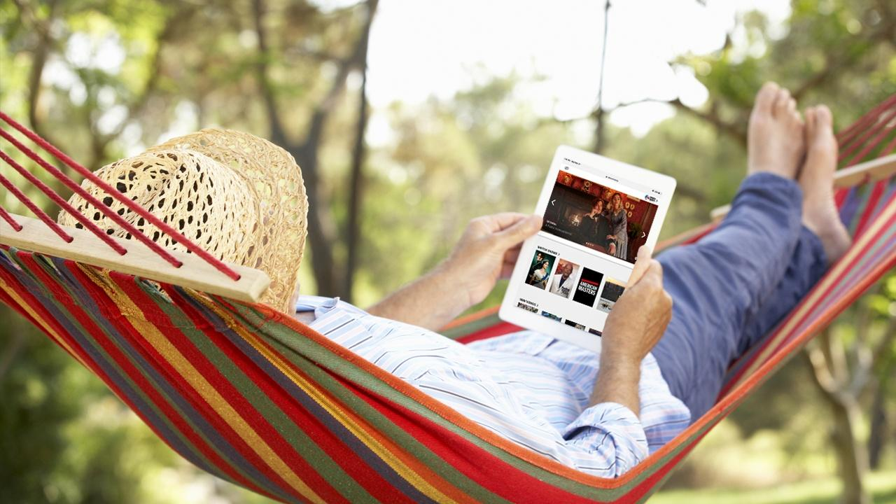 man in hammock viewing WNED PBS on his ipad