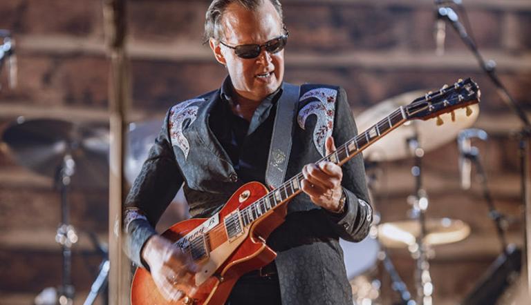Joe Bonamassa playing a guitar.