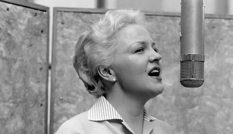 Peggy Lee singing in front of microphone