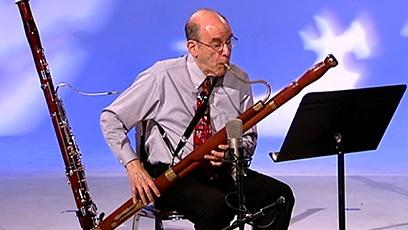 PSO principal bassoon Michael Dicker demonstrates the sounds of the bassoon
