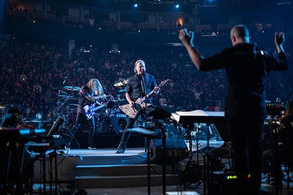Metallica joined forces with the San Francisco Symphony for a spectacular concert. Guitarist James Hetfield (center). San Francisco Symphony conductor Edwin Outwater (right).