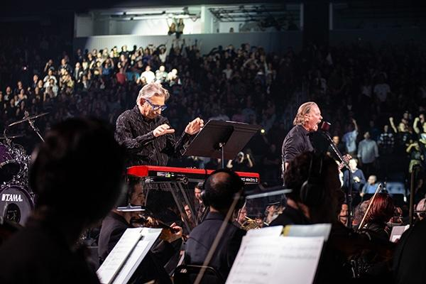 Musical Director Michael Tilson Thomas (left) conducts the San Francisco Symphony. James Hetfield, lead vocalist, rhythm guitarist and co-founder of Metallica (right).