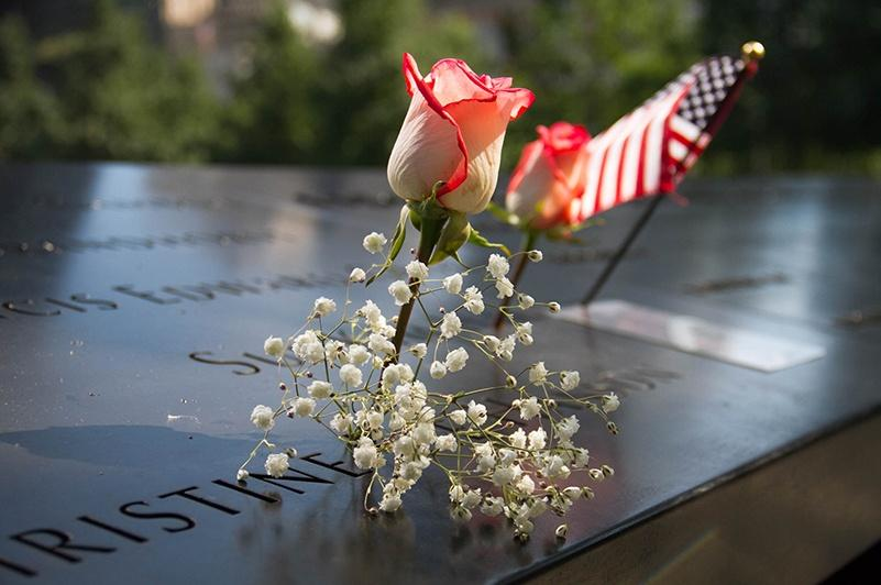 US Flag and flowers at 911 memorial