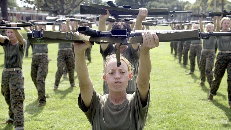Soldiers exercising with riffles