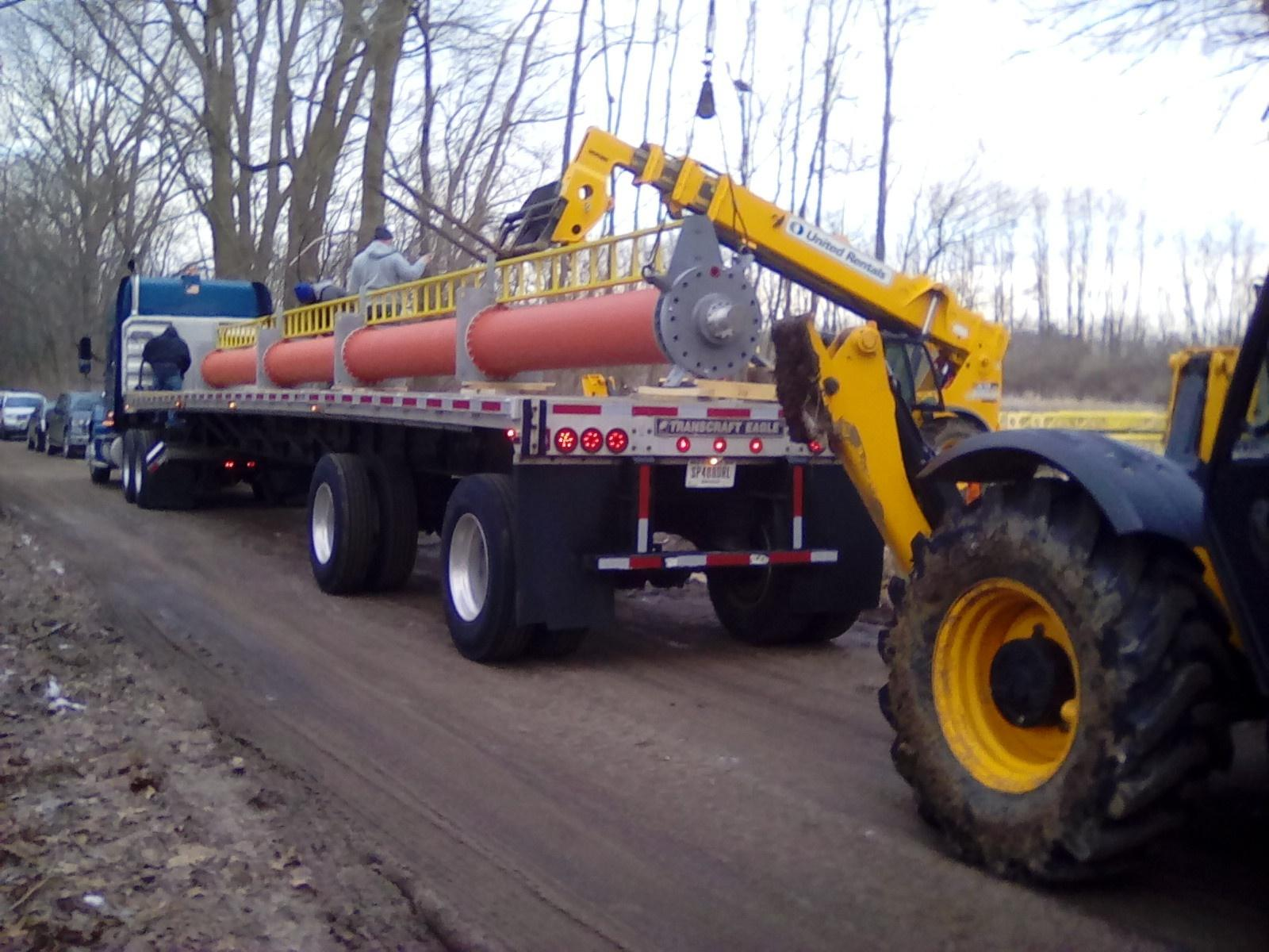 Antenna being off loaded from flatbed