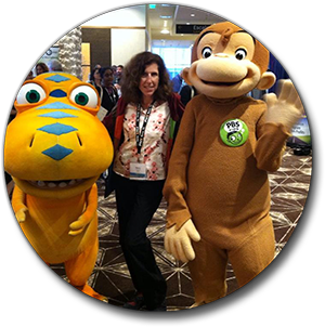Stacey with Curious George and Buddy the Dinosaur