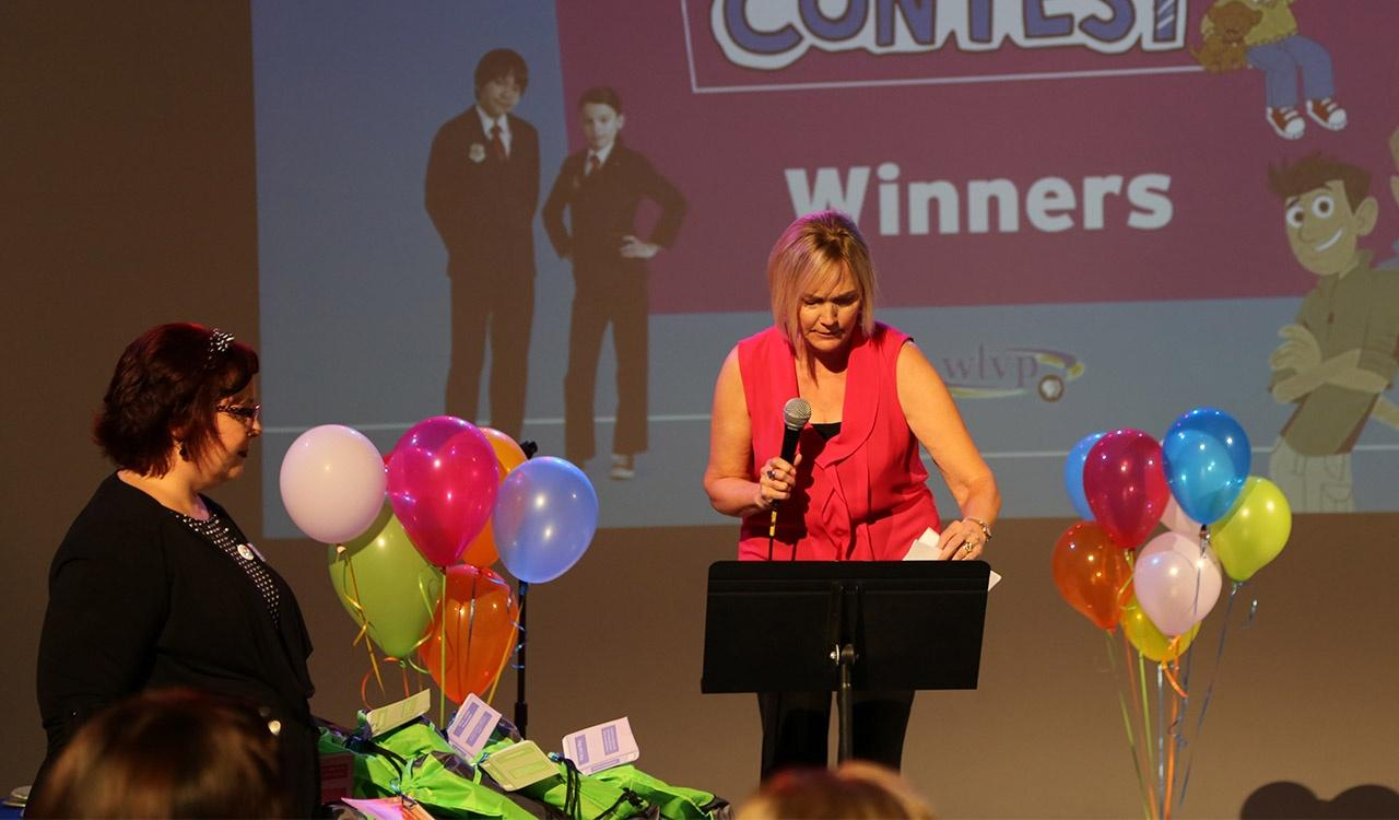 Mary announcing the first winner at 2017 Writers Contest Event