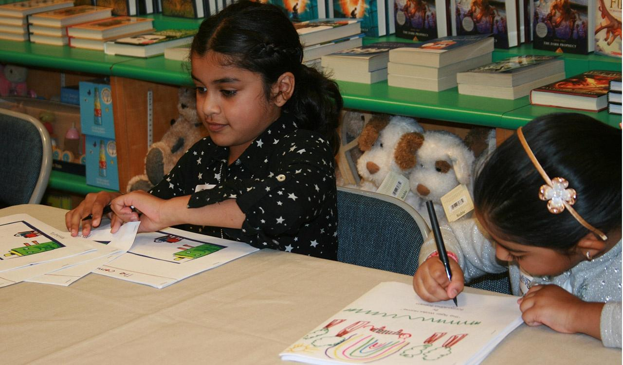 Akshara and Samyuktha signing their books at Barnes and Noble