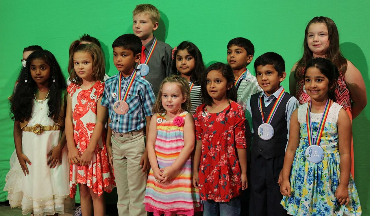 2017 Writers Contest Group Shot in front of Green Screen