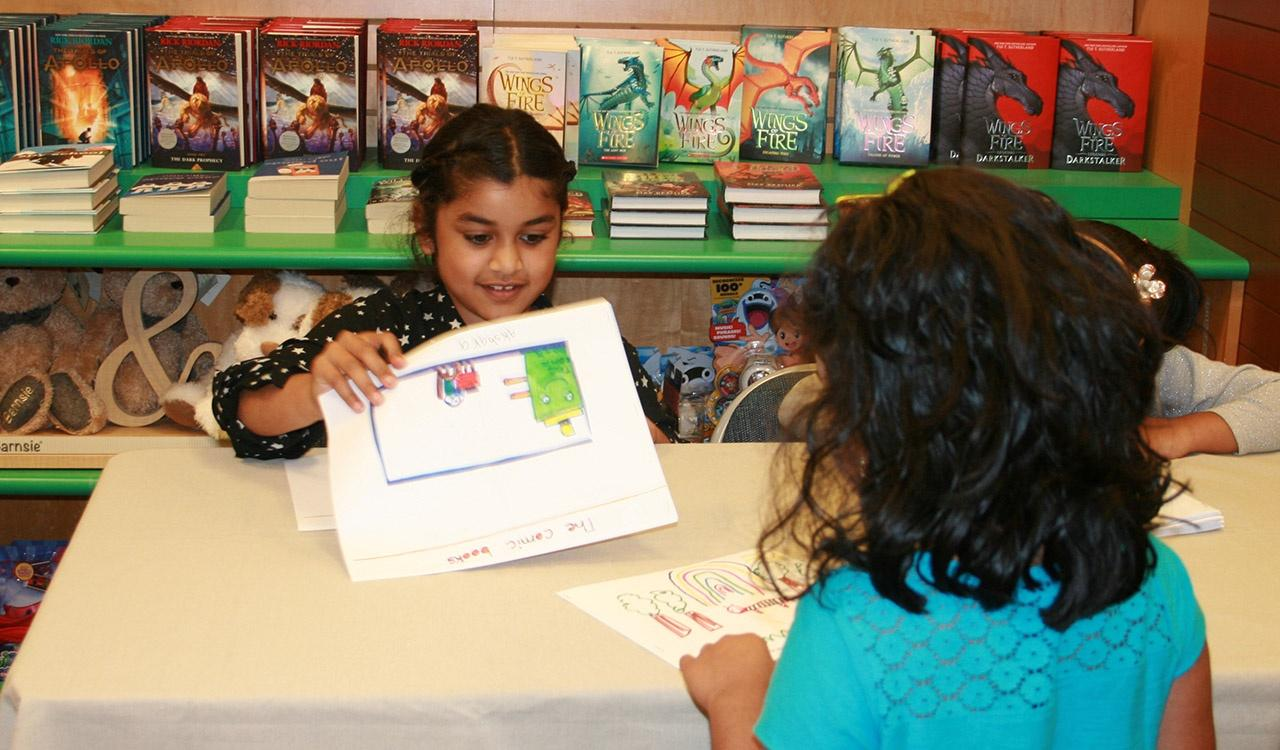 First Grade winner Akshara signing her book at Barnes and Noble