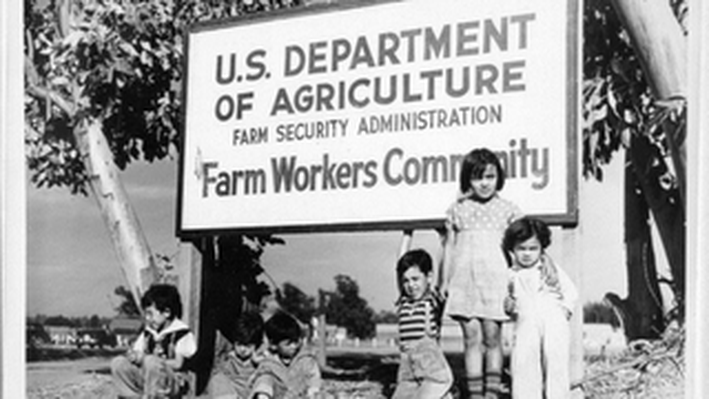 Group of Children Posing Under Sign