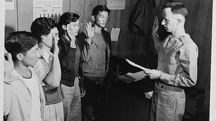 Major Charles V. McManus Administering the Oath to Four AJA volunteers