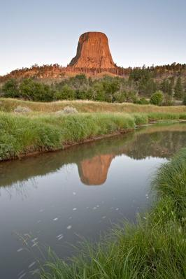 Devil's Tower Reflected in a Stream, Wyoming, United States of America, North America | Earth's Surface