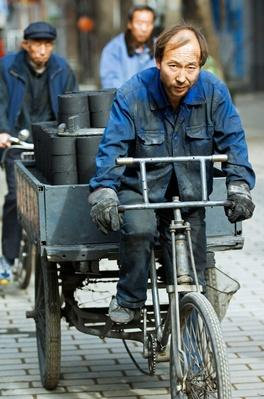 Men Transporting Charcoal Bricks Hutong, Beijing, China | Earth's Resources