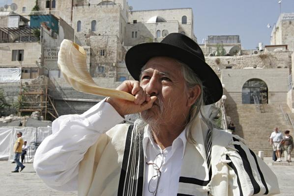 Blowing a shofar near the Wailing Wall | Musical Instruments