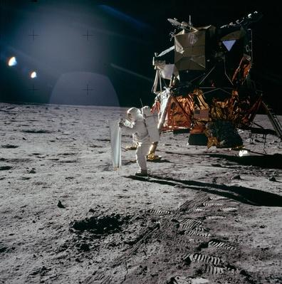 Apollo 11 astronaut Buzz Aldrin deploying the Solar Wind Collector on the moon | NASA Missions and Milestones in Space Flight