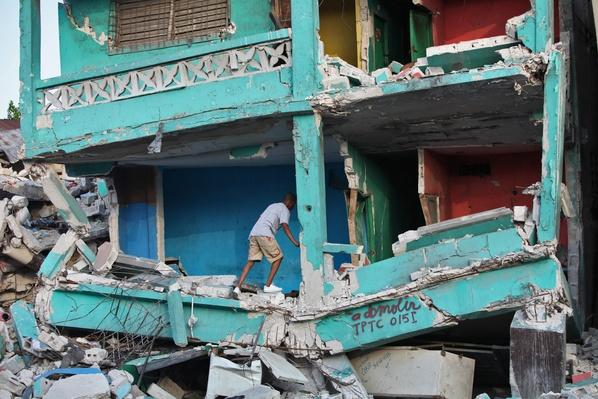 Crawling through a Building Demolished by Earthquake, Haiti, 2010 | Natural Disasters: Hurricanes, Tsunamis, Earthquakes