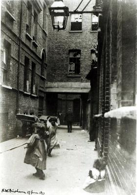 Children playing in a slum, 1899