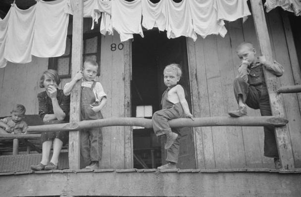 Children On Porch, Leaning On Railing | Ken Burns: The Dust Bowl