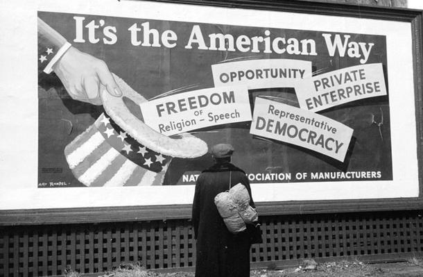Migrant Man Looking up at Billboard | Ken Burns: The Dust Bowl