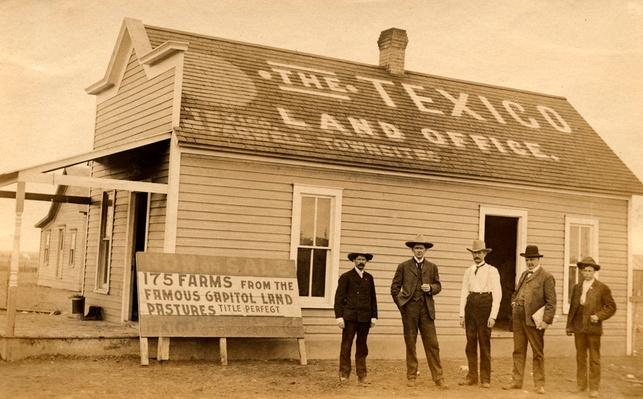 """Five Men Pose Outside of """"The Texico Land Office"""" 