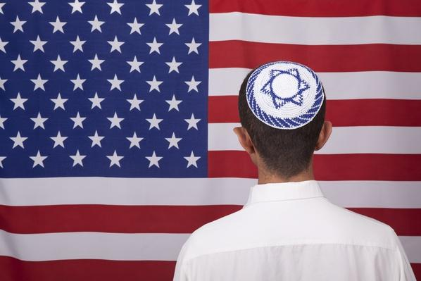 Jewish Citizen Wearing Yarmulke In Front Of American Flag | World Religions: Judaism
