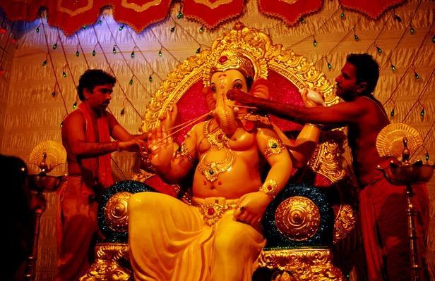 Priests attending Ganesh murti | World Religions: Hinduism
