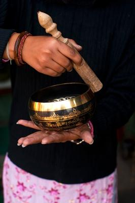 Sales woman with singing bowl, Swayambhunath Stupa | Musical Instruments