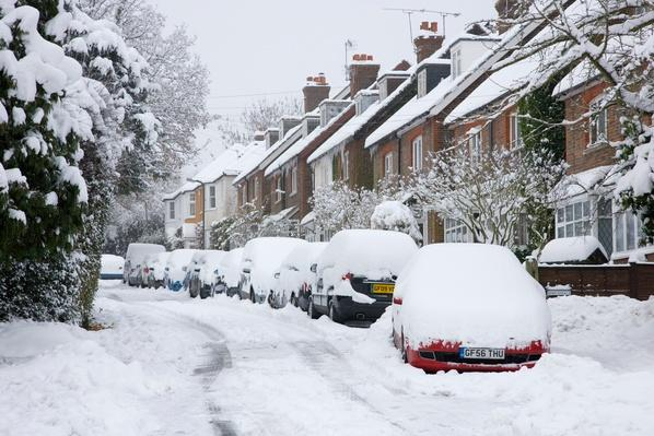 Parked cars in thick snow after blizzard | Weather
