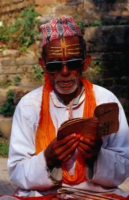 A Brahmin priest reads at the Vishnu shrine | World Religions: Hinduism