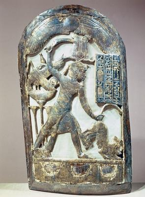 Votive shield depicting the king slaying a lion, from the tomb of Tutankhamun