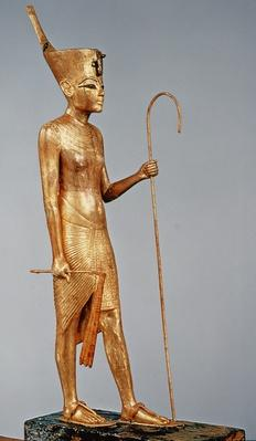 Statuette of the king wearing the red crown of the north, from the tomb of Tutankhamun