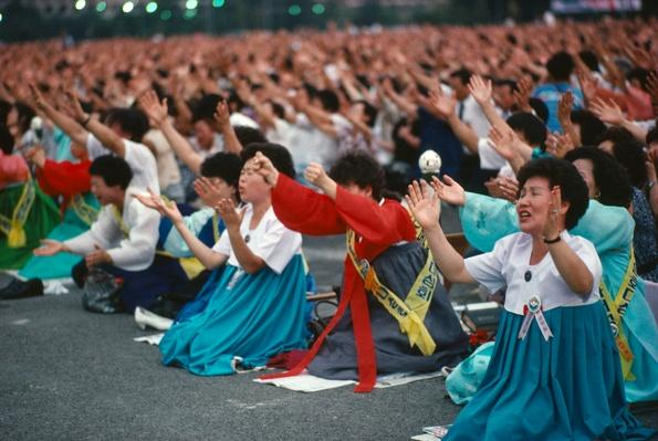 Evangelical Christian crusade. Crowds in state of religious fervor. Seoul South Korea | World Religions: Christianity