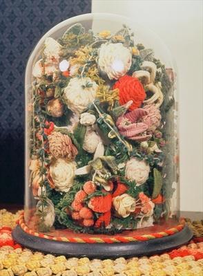 Victorian woollen flowers in a glass case